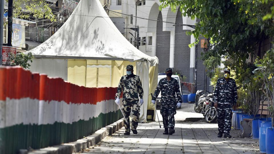 Paramilitary personnel seen at the cordoned off entry route to the Tablighi Jamaat's Alami Markaz Banglewali Masjid building in Nizamuddin, New Delhi, India, on Monday, April 13, 2020.