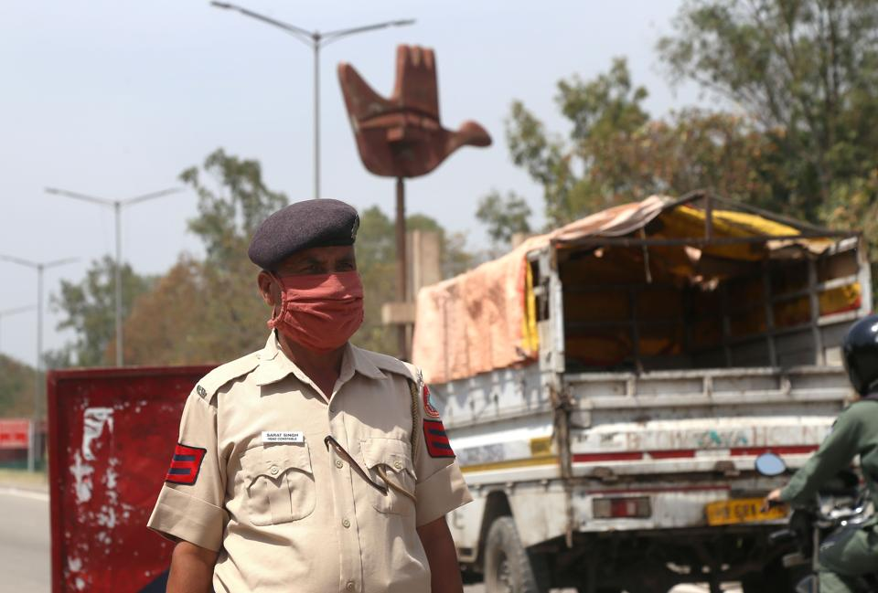 Police checking vehicles in the second phase of the lockdown on the Chandigarh-Zirakpur border on Tuesday.