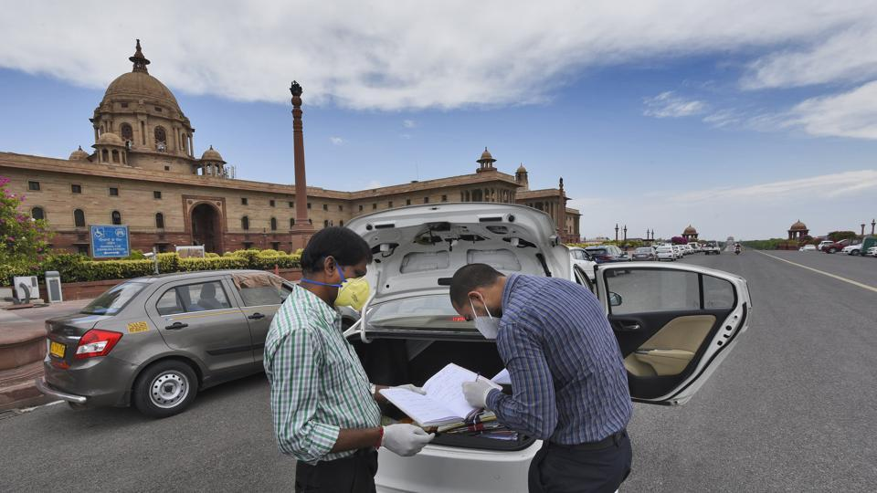 Government employees seen outside North Block as ministries and government offices partially resume working from offices, at Raisina Hills, in New Delhi, India, on Monday, April 20, 2020.