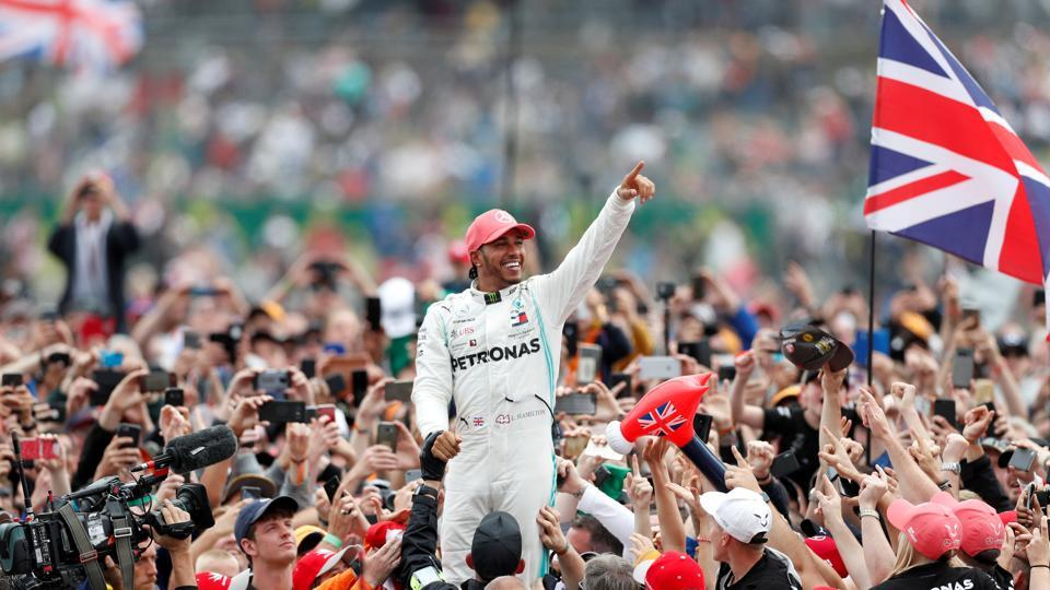 Mercedes' Lewis Hamilton celebrates with the crowd after winning the race.