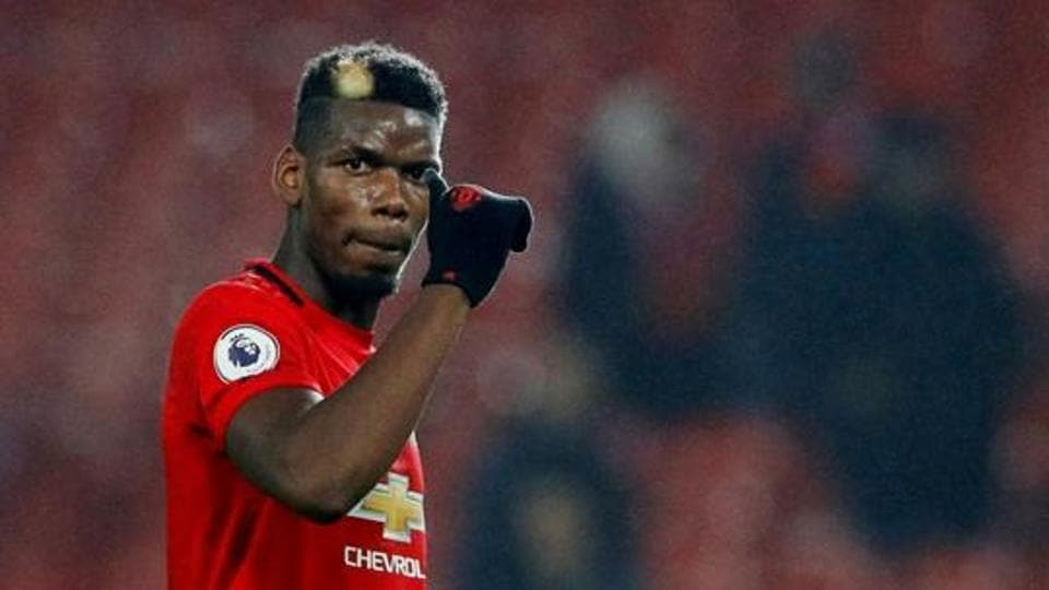 Manchester United's Paul Pogba acknowledges fans after the match.