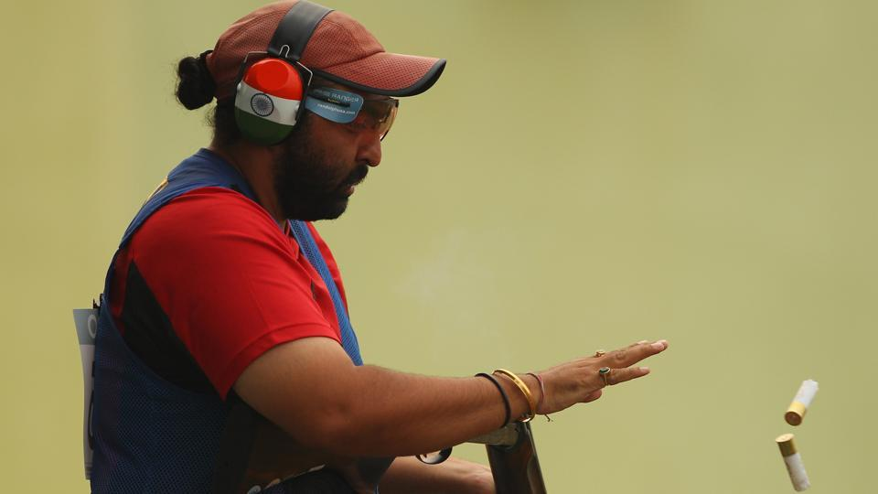 Ronjan Sodhi of India competes in the men's double trap at the Dr Karni Singh Shooting Range.