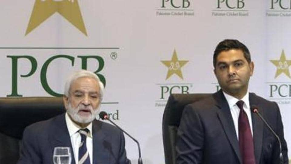 Pakistan Cricket Board's new managing director Wasim Khan, right, looks on during a press conference with the PCB Chairman Ehsan Mani in Lahore.