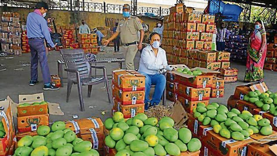 A vendor waits for customers at Azadpur mandi on Tuesday.