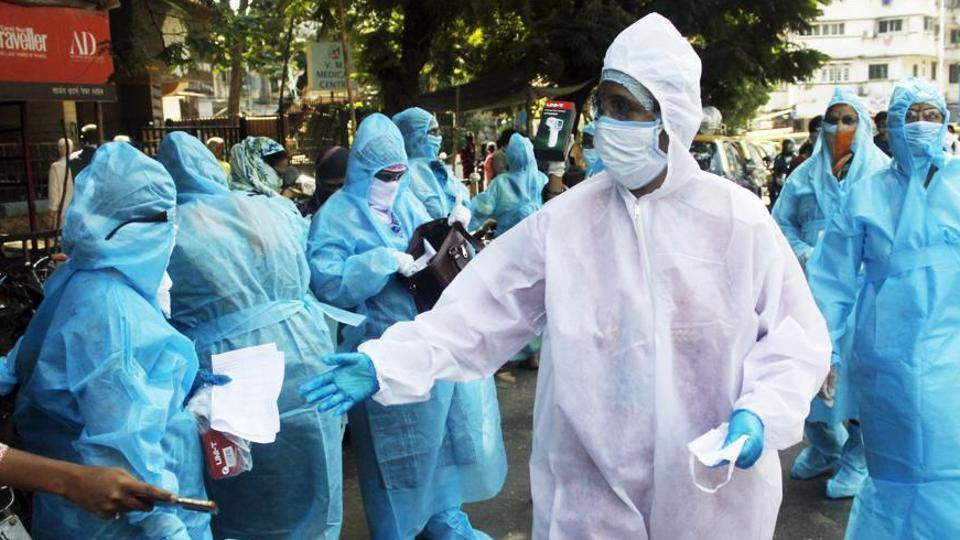 Medical staff wearing protective suit walk into a slum area at Worli to test the residents for coronavirus during the nationwide lockdown to limit the spreading of coronavirus disease in Mumbai on April 20.