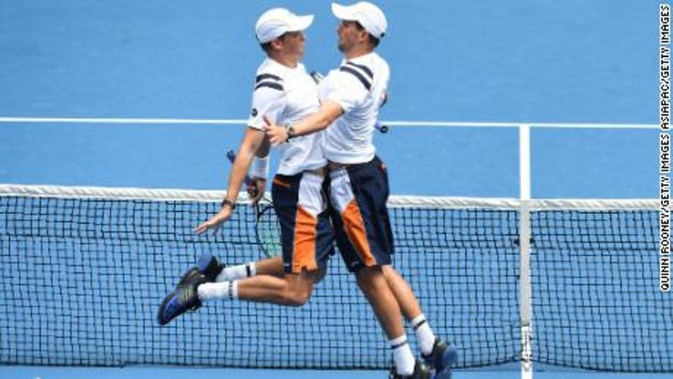 """The U.S. Tennis Association is warning folks: """"No Bryan Brothers chest bumps."""