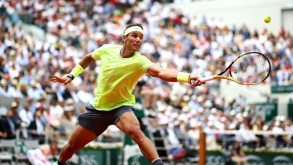 Rafael Nadal of Spain plays a backhand at the French Open.