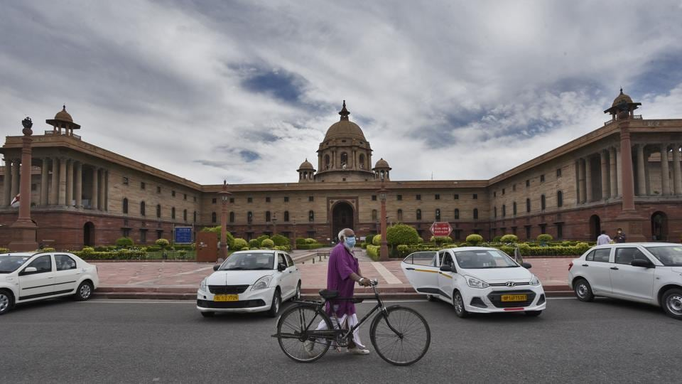 An elderly man walks along with his bicycle in the direction of the Prime Minister's office, at Raisina Hills, in New Delhi, India, on Monday, April 20, 2020.