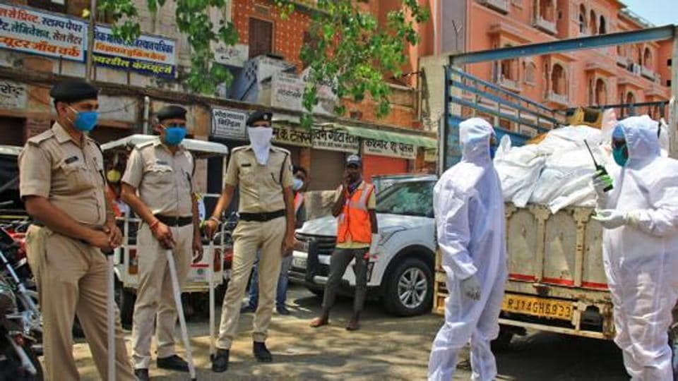 Rashan distributor wears PPE kit during the nationwide lockdown imposed in the wake of the deadly novel coronavirus pandemic, in Jaipur on Friday.