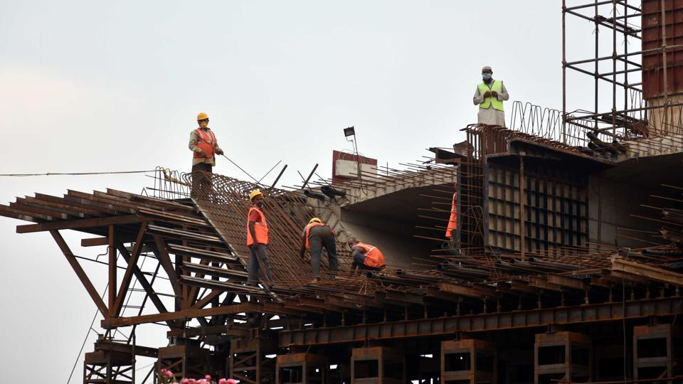 Labourers working on an under construction flyover after relaxations in lockdown conditions at Bailey road in Patna, Bihar