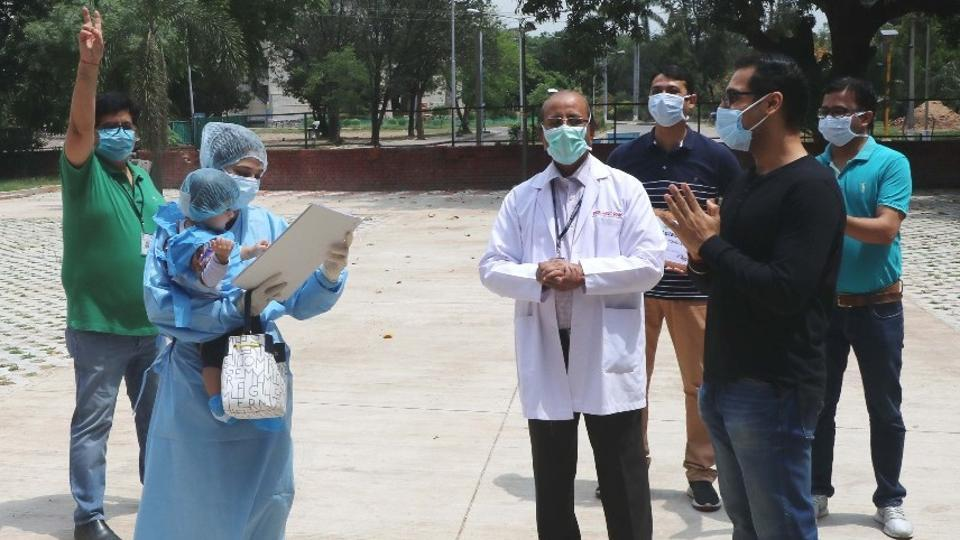 The infant who recovered from Covid, in her mother's arms, being discharged from PGIMER, Chandigarh on Sunday.
