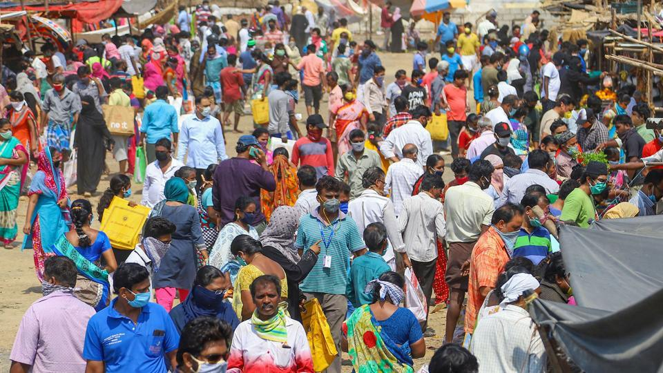 day before total lockdown, huge crowd is seen to buy vegetables and groceries at a market, during a nationwide lockdown in the wake of coronavirus pandemic in Chennai on Saturday.