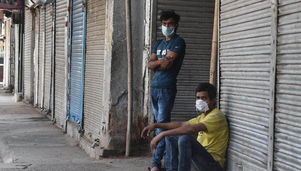 Men seen wearing facemasks during lockdown, at Ajmeri Gate, in New Delhi, India, on Monday, April 27, 2020.