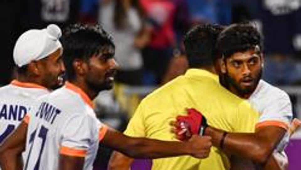 Varun Kumar (C) of India celebrates after scoring a goal during the men's field hockey match between India and England at the 2018 Gold Coast Commonwealth Games on April 11, 2018.