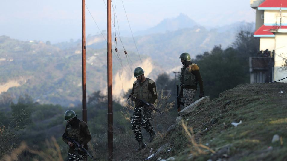 Indian security force soldiers patrol near the site of a gunbattle at Nagrota , on the outskirts of Jammu, India.