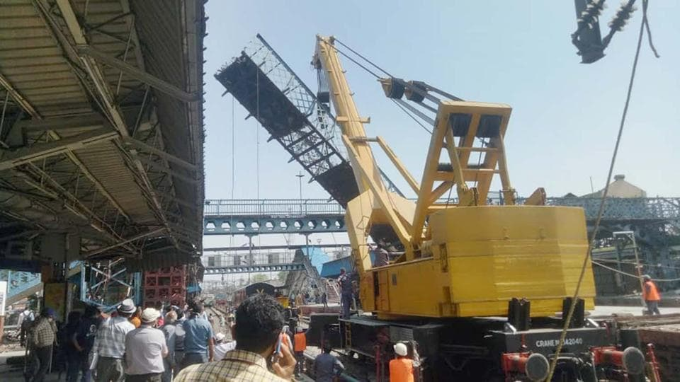 Workers dismantling a bridge at Ludhiana railway station on Monday.