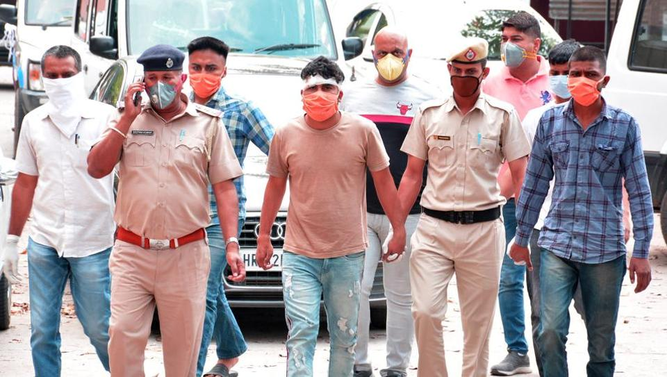 The four gangsters arrested from Chandimandir being produced in a local court in Panchkula on Monday.