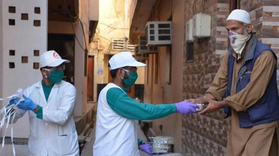 Health workers providing food packets and masks to Muslim residents, Chandigarh April  11, 2020