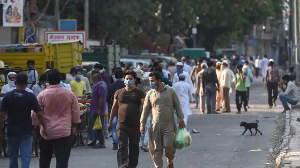People come out during Covid-19 lockdown, at Sadar Bazaar in New Delhi, on Monday.