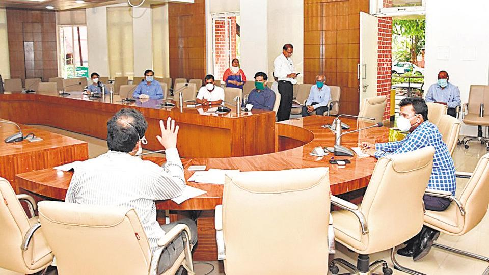 Officials of private hospitals and district administration during a meeting on Monday.