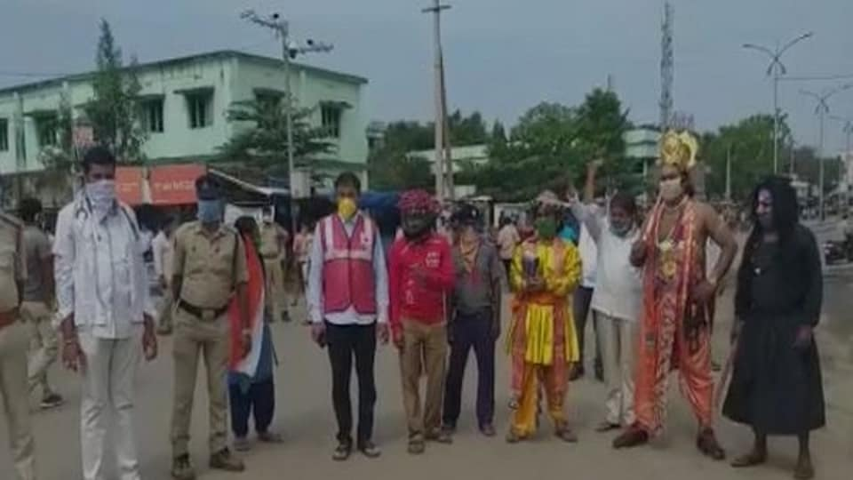 The image shows a man dressed as 'Yamraj' standing with others while wearing masks.