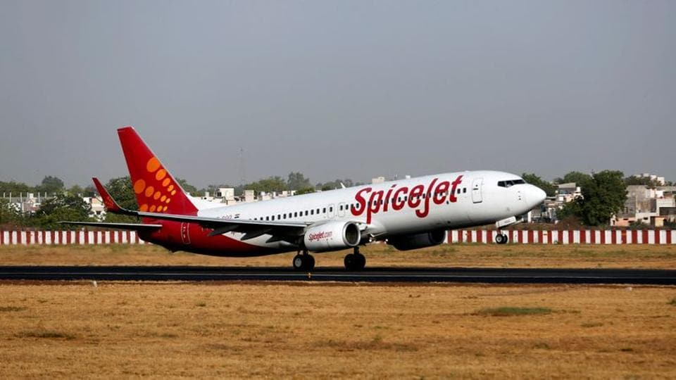 A SpiceJet passenger Boeing 737-800 aircraft takes off from Sardar Vallabhbhai Patel international airport in Ahmedabad, India.
