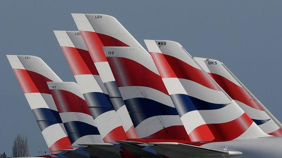Tail Fins of British Airways planes are seen parked at Heathrow airport as the spread of the coronavirus disease (COVID-19) continues, London.