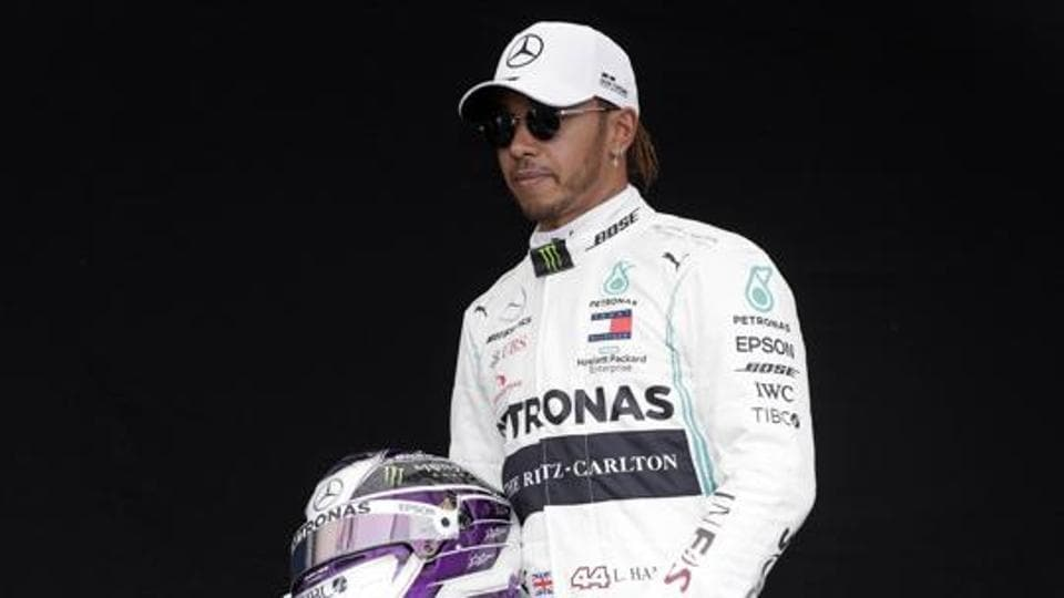Mercedes driver Lewis Hamilton of Britain poses for a photo at the Australian Formula One Grand Prix in Melbourne.
