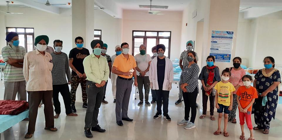 The pilgrims who returned from Hazur Sahib, Nanded, in Maharashtra on Sunday, with health department personnel during their screening in a civil hospital in Amritsar.
