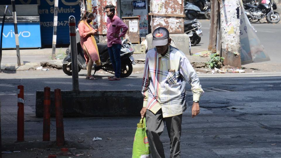 A senior citizen ventured out of home to purchase essential things in Pune.  Authorities say mainly senior citizens and people will comorbid conditions like diabetics, blood pressure, heart and kidney-related ailments are vulnerable to coronavirus.