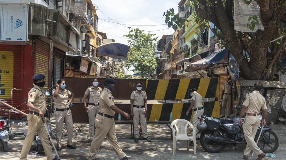 Police personnel at a containment zone in Shivaji Nagar during nation wide lockdown due to corona virus, Govandi, Mumbai,  April 27 2020.