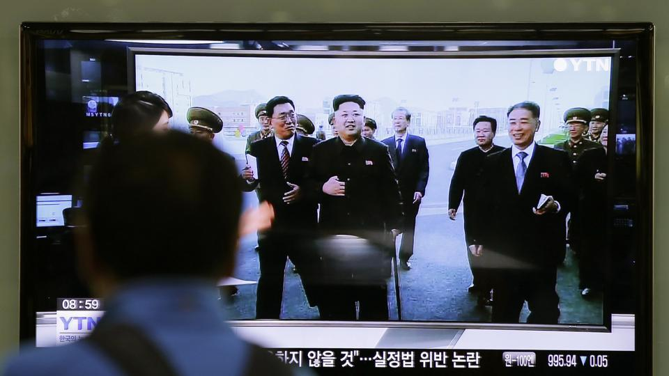 FILE - In this Oct. 14, 2014 file photo, a man watches a TV news program at the Seoul Railway Station in Seoul, South Korea, showing North Korean leader Kim Jong Un using a cane, reportedly during his first public appearance in five weeks in Pyongyang, North Korea.