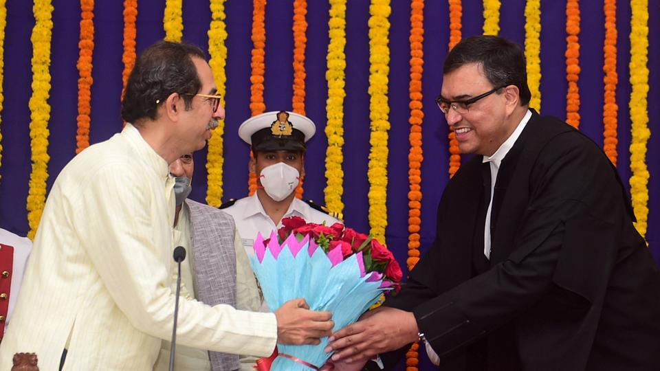 Maharashtra Chief Minister Uddhav Thackeray (L) greets the newly sworn-in Chief Justice of the Bombay High Court Justice Dipankar Datta during his oath ceremony at Rajbhavan in Mumbai, Tuesday, April 28, 2020.