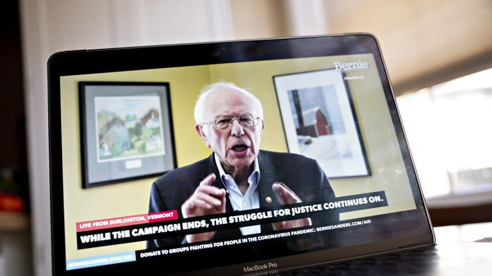 Senator Bernie Sanders, an Independent from Vermont and former 2020 presidential candidate, speaks during a livestream event on a laptop computer in this arranged photograph in Arlington, Virginia, US, on Wednesday, April 8, 2020. Sanders ended his presidential run today after an unbroken string of losses in recent weeks that cemented Joe Biden's all-but insurmountable lead in delegates.