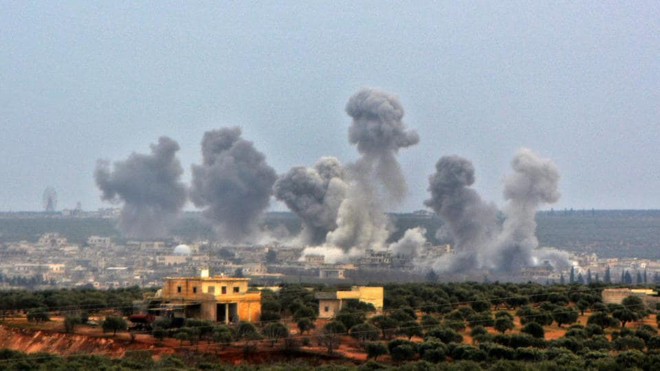 A picture taken on February 24, 2020, shows smoke billowing over the village of Qaminas, about 6 kilometres southeast of Idlib city, following reported Syrian air strikes. (Photo for representative purpose only)