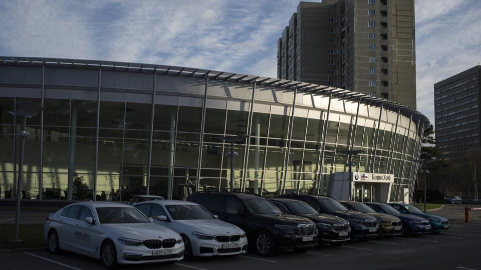 In this photo taken on Thursday, April 23, 2020, new cars are parked in front of the closed car dealership in Moscow, Russia.