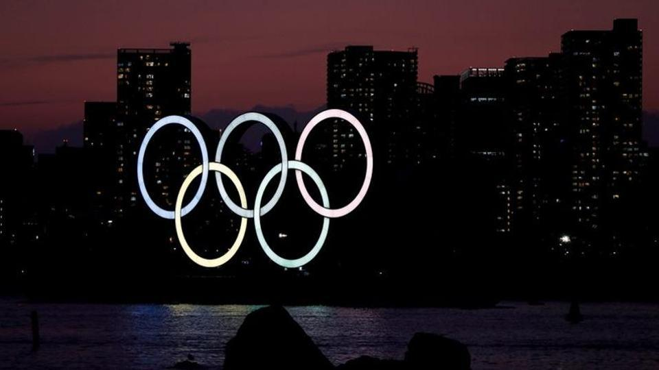 The giant Olympic rings are seen in the dusk at the waterfront area at Odaiba Marine Park in Tokyo.