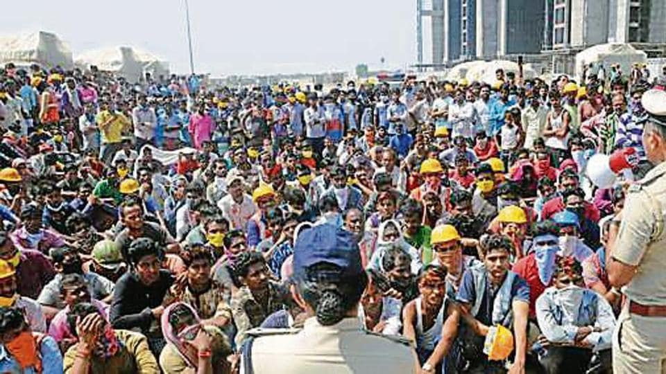 Police officials appeal to protesting migrant workers to maintain calm at Diamond Bourse construction site, in Surat on Tuesday.