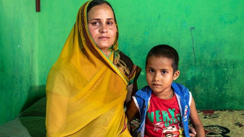 Seen here is Radhika, the slain jawan's wife, with her son. (HT photo)