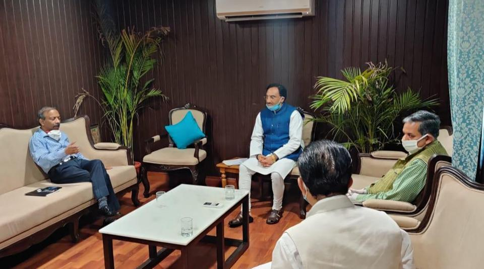 HRD minister with secretary Amit Khare and UGC officials.
