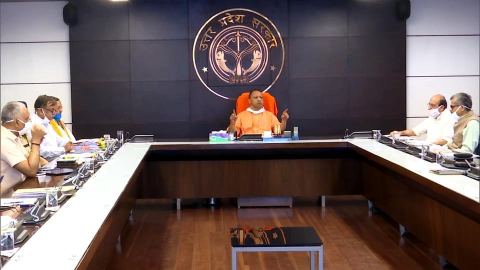Uttar Pradesh Chief Minister Yogi Adityanath chairs a meeting with 'Covid-19 management Team-11' of the state in Lucknow on Tuesday.