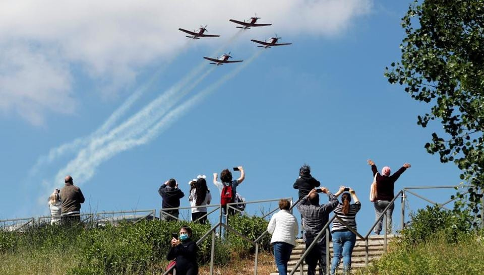 People watch as Israeli Air Force planes fly in formation over Jerusaelm as part of the Israel's 72nd Independence Day events taking place amid coronavirus disease (Covid-19) restrictions around the country, in Jerusalem April 29, 2020.