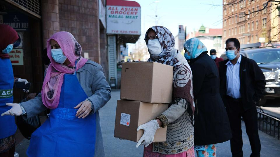 Halal food boxes are distributed to those in need during Ramzan on April 28, 2020 in the Brooklyn borough of New York City amid the coronavirus pandemic.  Covid-19  deaths in the United States neared 59,000 as on April 28, 2020.
