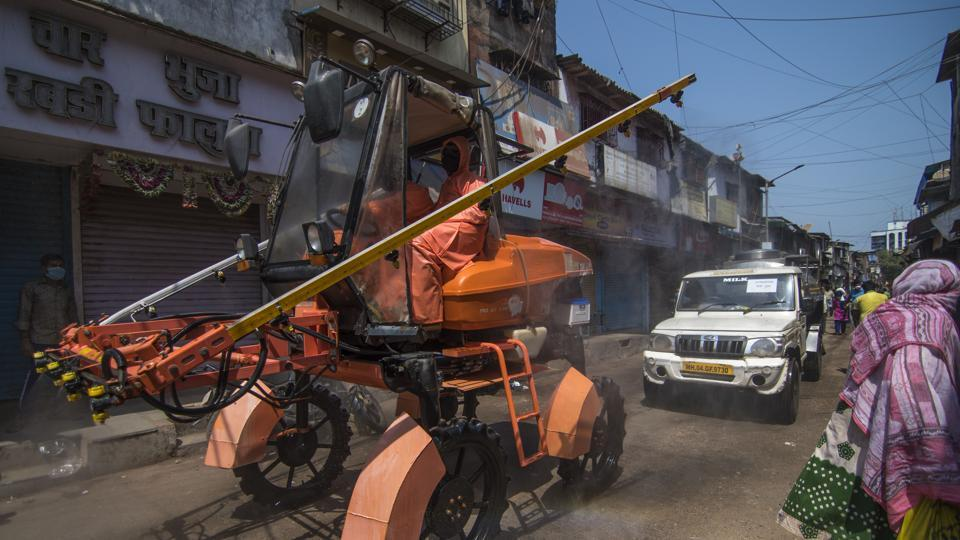 Mumbai Fire brigade officials Sanitise the area using sodium hypochlorite solution during nationwide lockdown due to Covid-19 Coronavirus at Dharavi in Mumbai.