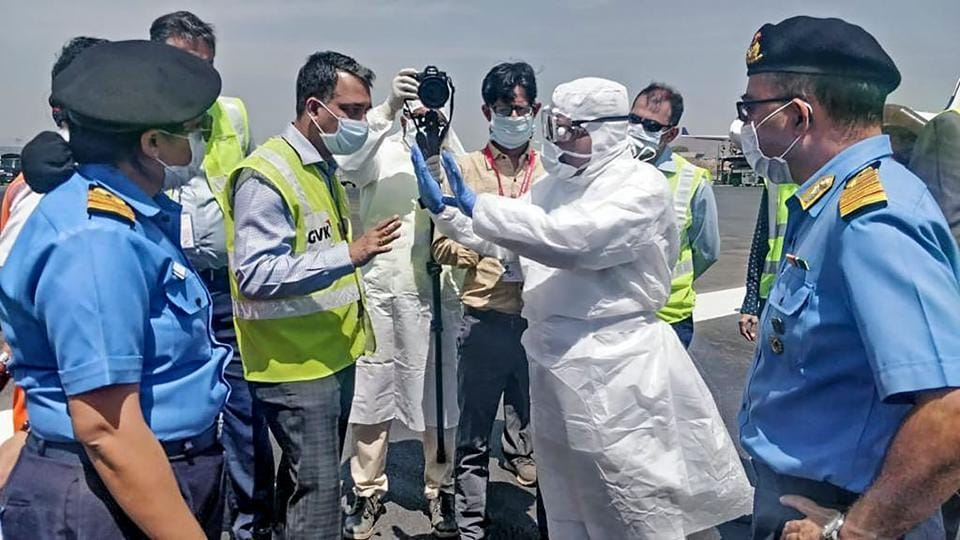 Medical team members from the Navy, wearing protective gear, brief airport officials before the evacuation of Indian nationals from Iran and their arrival in India, at Chhatrapati Shivaji International Airport in Mumbai on March 13, 2020.
