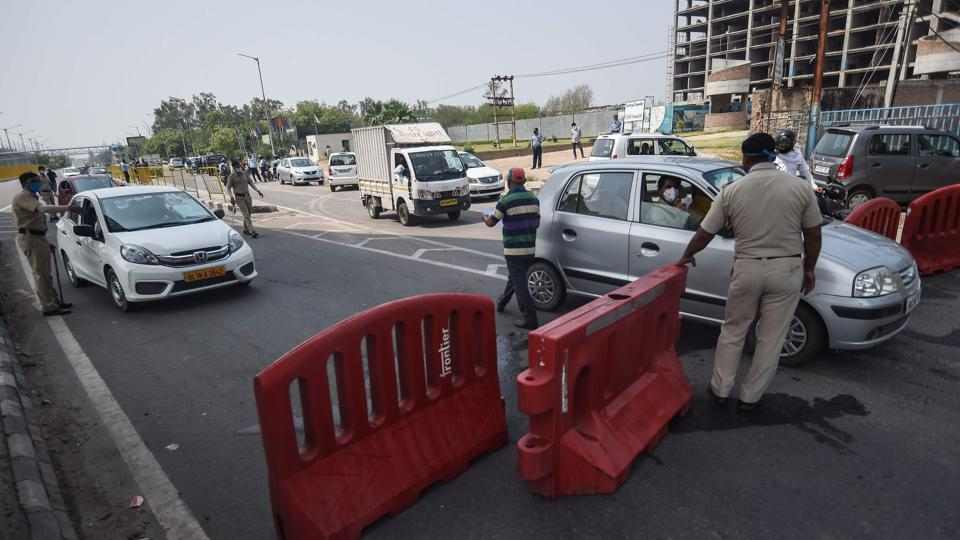 Vehicles are stopped at the state border to cross to Delhi after Haryana government sealed its border with the national capital Delhi during a government-imposed nationwide lockdown as a preventive measure against coronavirus in Faridabad.