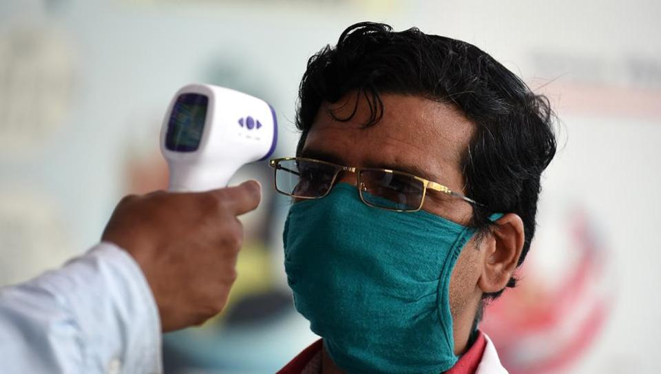 Visitors undergo thermal screening at Shatabdi Hospital (KGMU) during the lockdown, in Lucknow, Uttar Pradesh.
