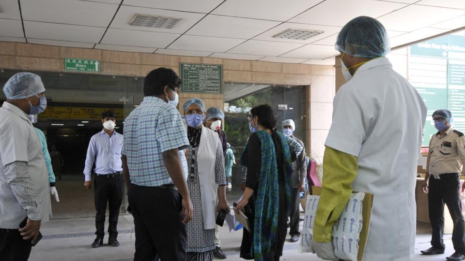 Medical professional seen at district hospital in Sector 30 during lockdown, in Noida.