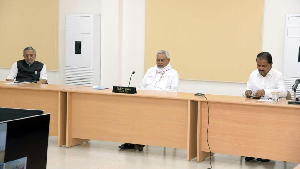 Bihar Chief Minister Nitish Kumar with officials during a video conference at Anne Marg, during lockdown to curb the spread of coronavirus, in Patna on Tuesday.