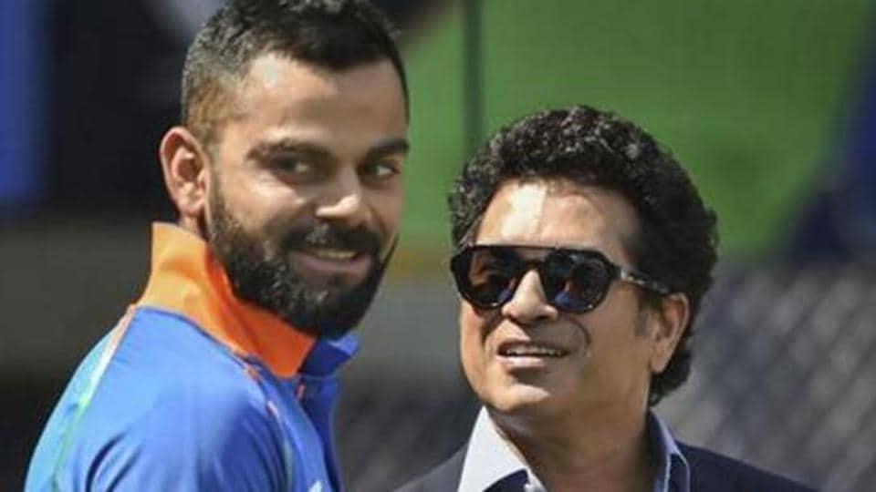 Virat Kohli (L)and Sachin Tendulkar.